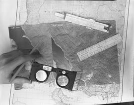 BCIT Programs Forestry Technology ; a hand holding a pencil and a pocket stereoscope ; aerial pho...