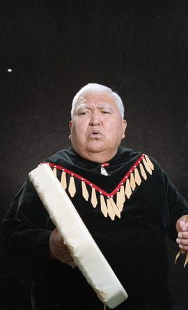 Bob George, First Nations elder, in First Nations garment playing an instrument [8 of 36 photogra...