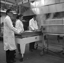 BCIT Food Technology program ; students standing at the end of a conveyor system