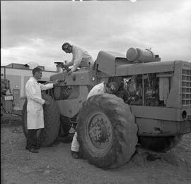 BCVS Heavy duty mechanic program ; three men working on a payloader [2 of 2]