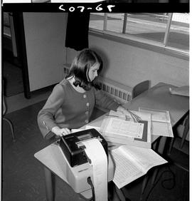 B.C. Vocational School; Commercial Program student in a classroom using an adding machine (6 of 10)