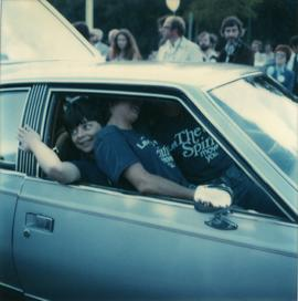 Student Rally 1984 ; three students sitting in the front seats of a car
