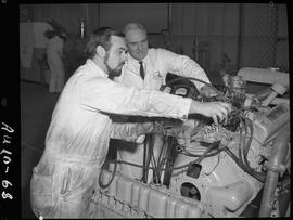 B.C. Vocational School image of an Automotive program instructor and student working on a vehicle...