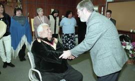 BCIT open house '98, First Nations elder shaking hands with a staff member [2 of 3 photographs]