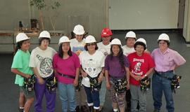 Pre-trade Aboriginal women; students wearing hard hats and tool belts [5 of 8 photographs]