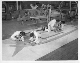 Students building a boat frame in a workshop; Photo by the Division of Visual Education, Dept. of...