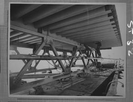 Structural steel; three men working on structural beams under A. Murray Mackay bridge connecting ...
