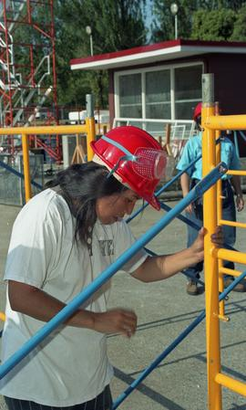 Pre-trade Aboriginal women; wearing hard hats and piecing together equipment [1 of 13 photographs]