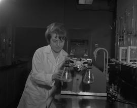 Food Processing Technology, 1966; woman in a lab coat using food processing equipment