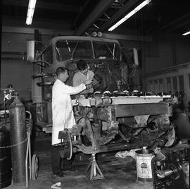 BCVS Heavy duty mechanic program ; a student and instructor looking at an engine cylinder for a l...