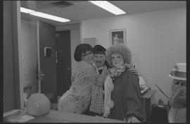 General Office staff dressed as a housewife (?), clown, and priest [6 of 11 photographs]