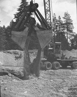 Heavy duty equipment operator, Nanaimo ; man controlling an excavator dumping dirt