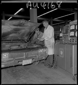 B.C. Vocational School image of an Instructor and Auto Mechanics program student working on an au...