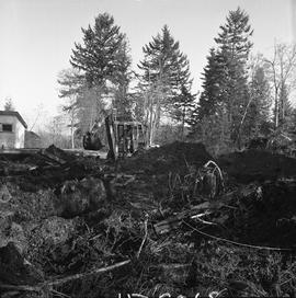 Heavy duty equipment operator, Nanaimo ; a man operating an excavator moving dirt ; debris in for...