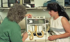 C/Care (students in action), 1993, student and nurse with medical machine [4 of 6 photographs]