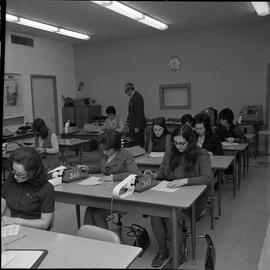 BC Vocational School Commercial Program; students in a classroom using adding machines ; instruct...