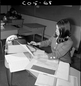 B.C. Vocational School; Commercial Program student in a classroom using an adding machine (4 of 10)