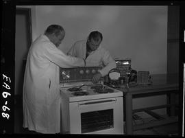 BC Vocational School image of an instructor and student in the Appliance Servicing program; takin...