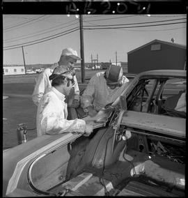 BC Vocational School image of Autobody program students working on a vehicle outside [2 of 2 phot...