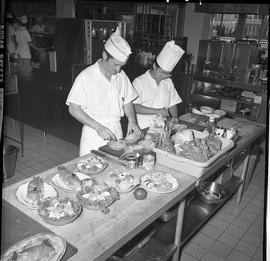BC Vocational School Cook Training Course ; two students preparing fruit bowls