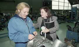 BCIT women in trades; aviation, female student working on aviation equipment inside a hangar besi...