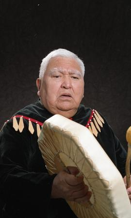 Bob George, First Nations elder, in First Nations garment playing an instrument [5 of 36 photogra...