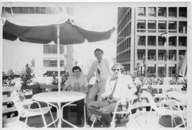 Ed Cook, Hospitality and Tourism instructor, sitting on a patio downtown with two other men