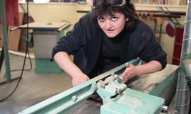 BCIT Women in Trades; carpentry, woman using bench tool (sander?) [3 of 5 photographs]