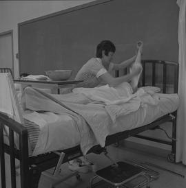 Practical nursing, Nanaimo, 1968; nurse washing a patient's arm [1 of 2]