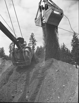 Heavy duty equipment operator, Nanaimo ; an excavator dumping dirt and an excavator scooping dirt
