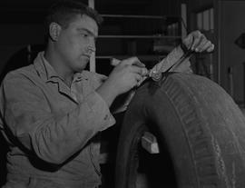 Tire repair, Nanaimo, 1967; student repairing a tire tread