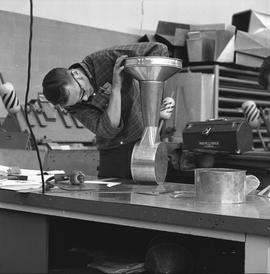 B.C. Vocational School, Sheet metal work course ; student building an engine order telegraph