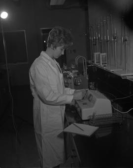 Food Processing Technology, 1966; woman in a lab coat using food processing equipment ; other equ...