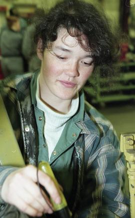BCIT women in trades; heavy duty, students in uniforms using mechanical tools and equipment [10 o...