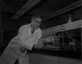 Food Processing Technology, 1966; man in a lab coat using food processing equipment [1 of 2]