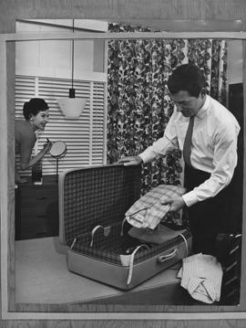 Hotel Motel Restaurant Administration Program; picture of a man packing a suitcase and a woman ap...