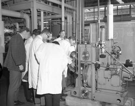 Mechanical technology, 1967; a group of men in lab coats looking at machinery [1 of 3]