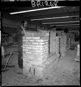 B.C. Vocational School image of Bricklaying students building brick fireplaces in the shop