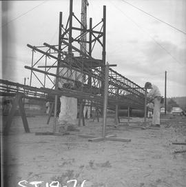 Structural steel, 1971; workers assembling a steel structure