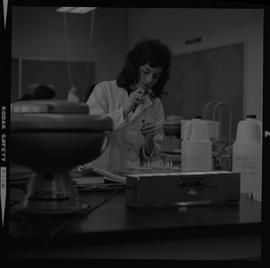 Medical laboratory technology, 1968; student working in a medical lab [3 of 3]