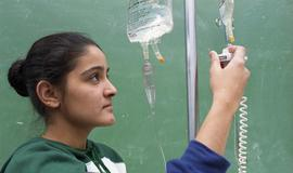 General Nursing, student checking intravenous drip bag [5 of 5 photographs]