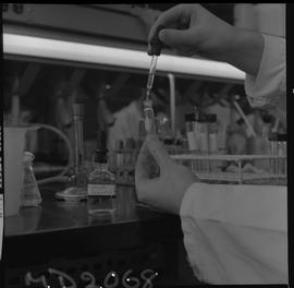 Medical laboratory technology, 1968; person using an eye dropper to add liquid to a test tube