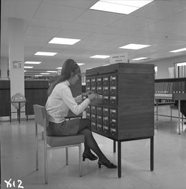 BCIT Library ; woman looking through card catalogue [1 of 2]