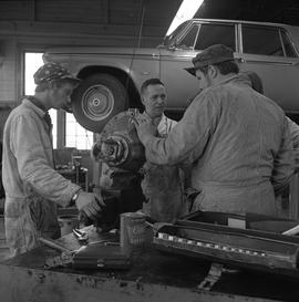 BCVS Heavy duty mechanic program ; group of men talking ; car on a car lift in background [2 of 2]