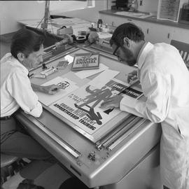BCVS Graphic arts ; two men working on an advertisement poster