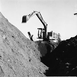 Heavy duty equipment operator, Nanaimo ; an Insley excavator on a large mound of dirt