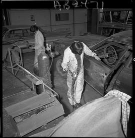 BC Vocational School image of Autobody program students working on a vehicle in the shop [8 of 8 ...
