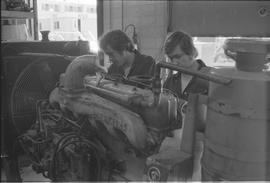 Pacific Vocational Institution ; two trade student working on an engine
