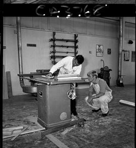B.C. Vocational School; inside of the Carpentry Trades shop with an instructor showing a student ...