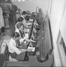 BCVS Graphic arts ; people adding folding papers to the conveyor for a staple binding machine [2 ...
